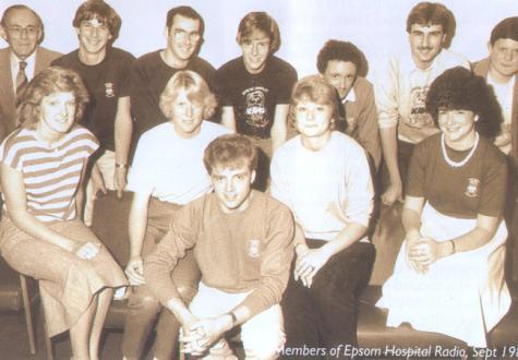 The Epsom Hospital Radio team of 1985.  Back Row, left to right are: John Campion, Simon Osborne, Trevor Leonard, George Ford, Andrew Vaughan, Robin Bennett and Hugh Thomas.  The ladies in front, left to right are: Laura King, Lesley Ansell, Nicki Jordan